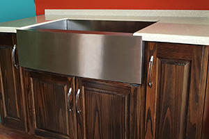 Apron/Farmhouse Sink, for those large wares, installed in a Walnut-stained Cabinet.